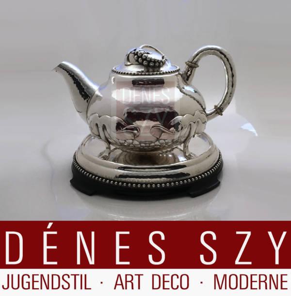Large Art Nouveau silver teapot on base, Design: Evald Nielsen approx. 1908-10, Execution: Evald Nielsen silversmith, Copenhagen 1913, 830 silver
